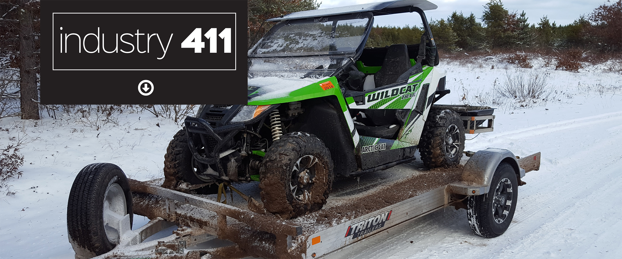 Photo of Tilt trailer with UTV covered in snow